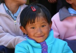 Young Nepalese girl wearing her new fleece jacket provided by the Tara Foundation USA