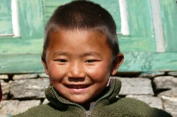 Happy Nepalese boy in his new fleece jacket from the Tara Foundation USA