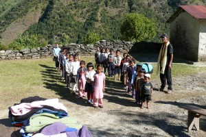Schoolchildren lined up and waiting to receive their new fleece jackets from the Tara Foundation Himalayan Children's Fleece Project