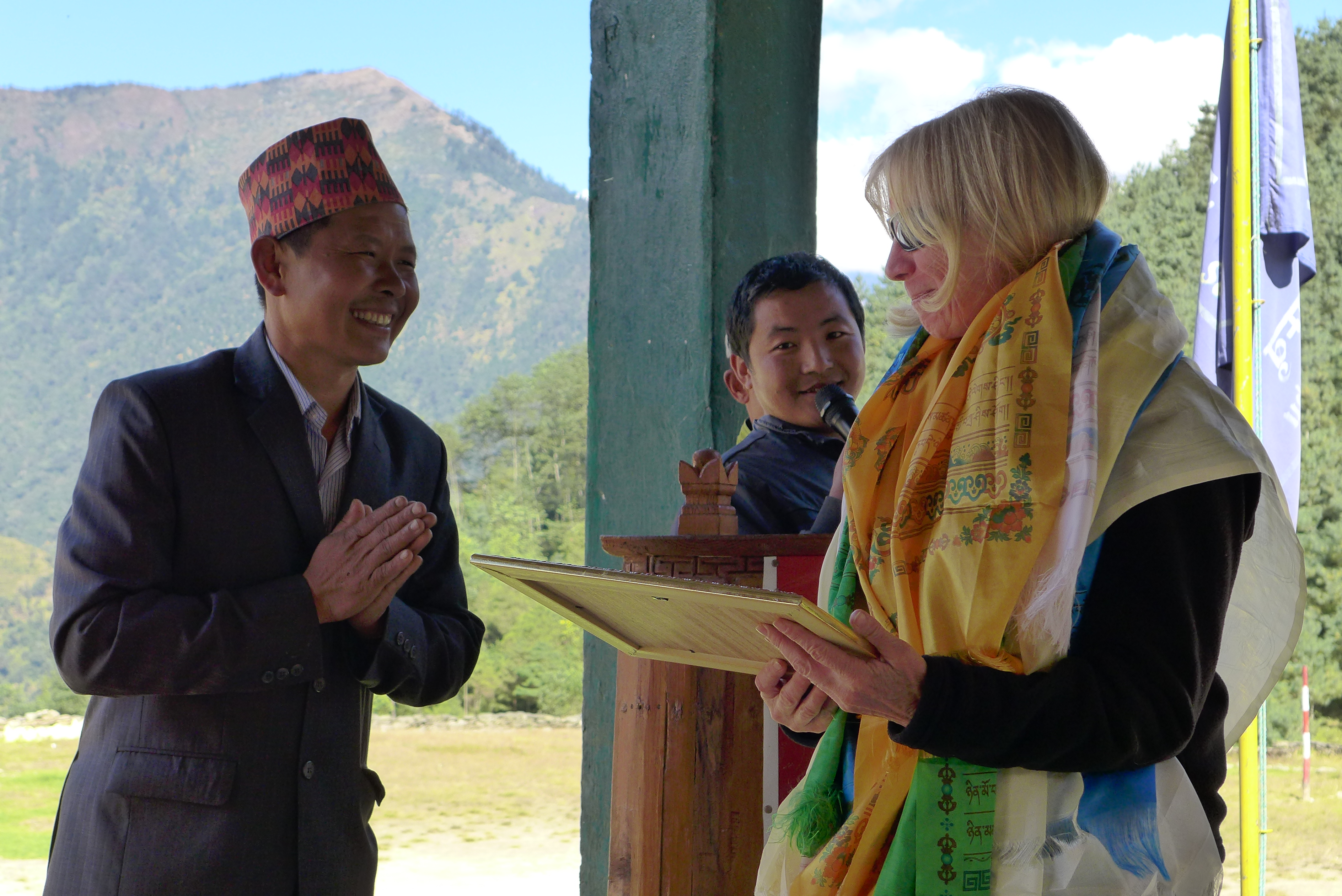 Denise Coriell of the Tara Foundation USA accepting a certificate from the people of Nunthala in appreciation of the Hew Khola Micro Hydro Power Plant Project funded by Tara Foundation USA.