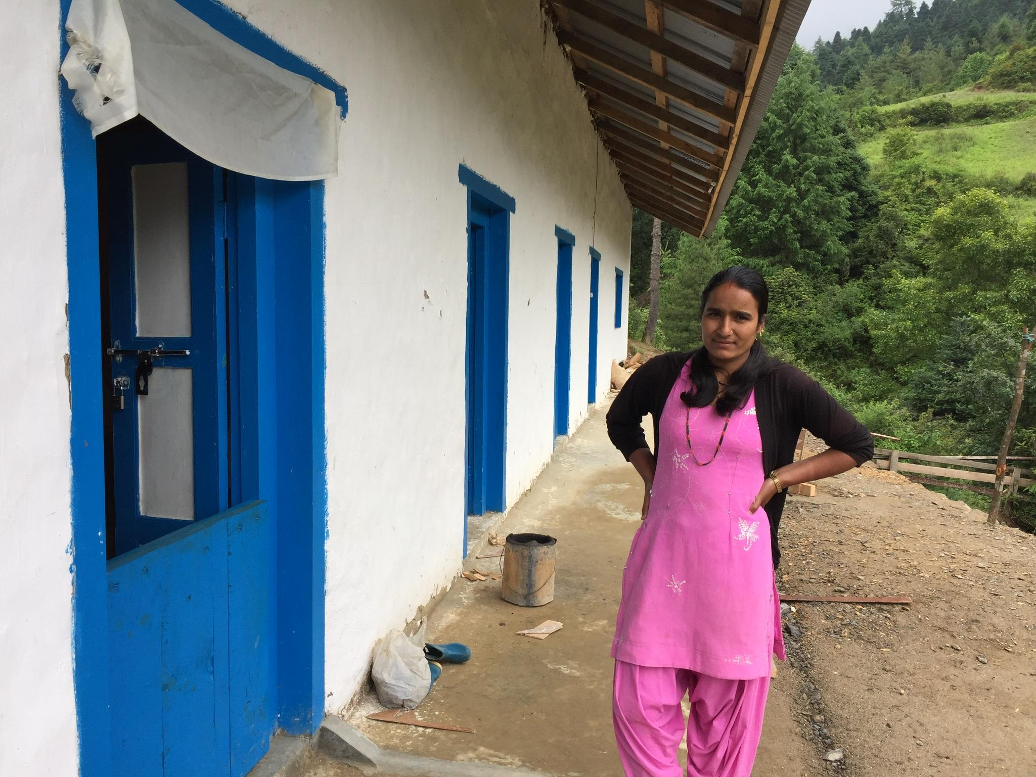Teacher in front of Shree Ringmu Teacher Hostel.