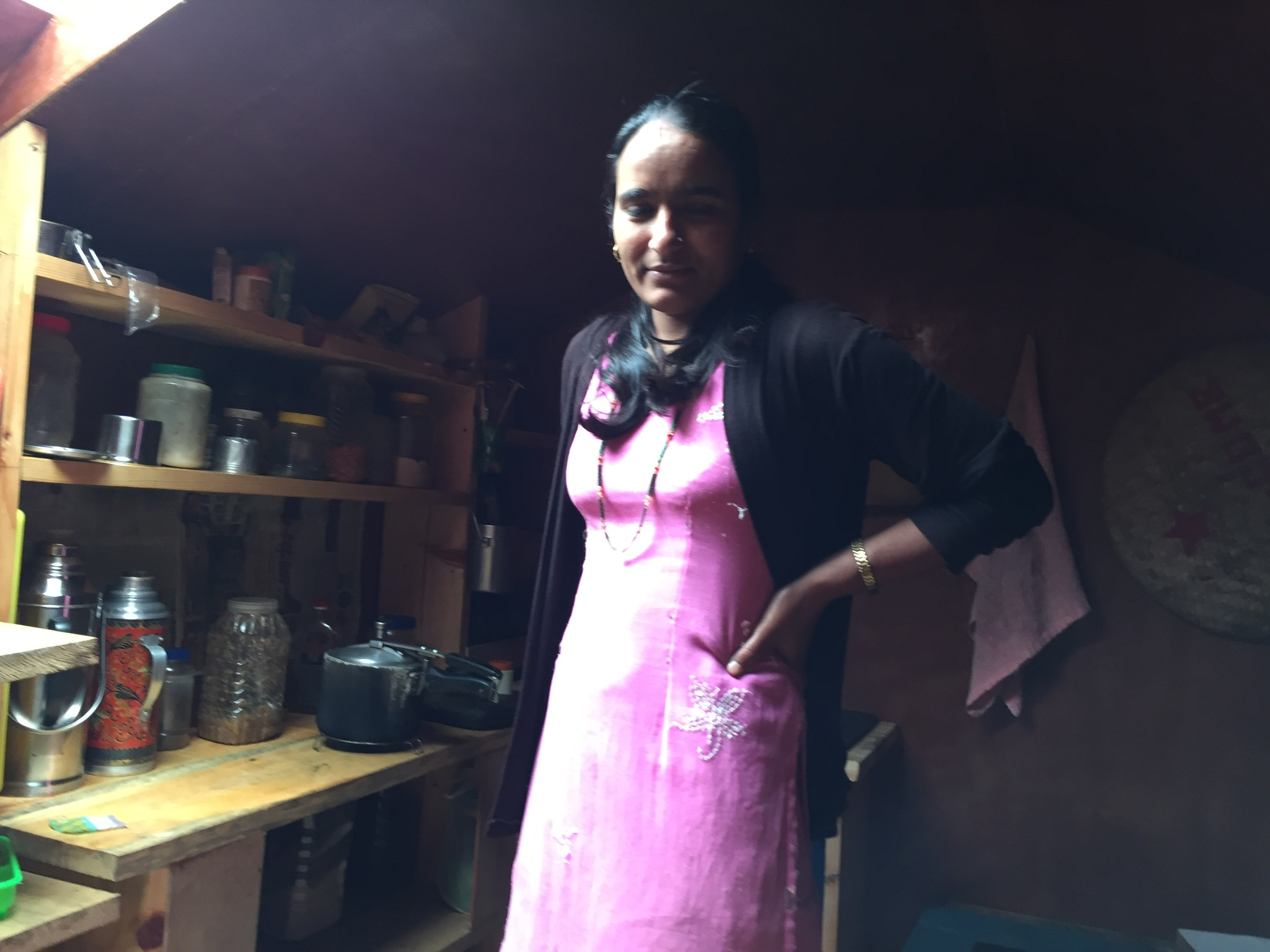 A teacher inside the Shree Ringmu Teacher Hostel kitchen.