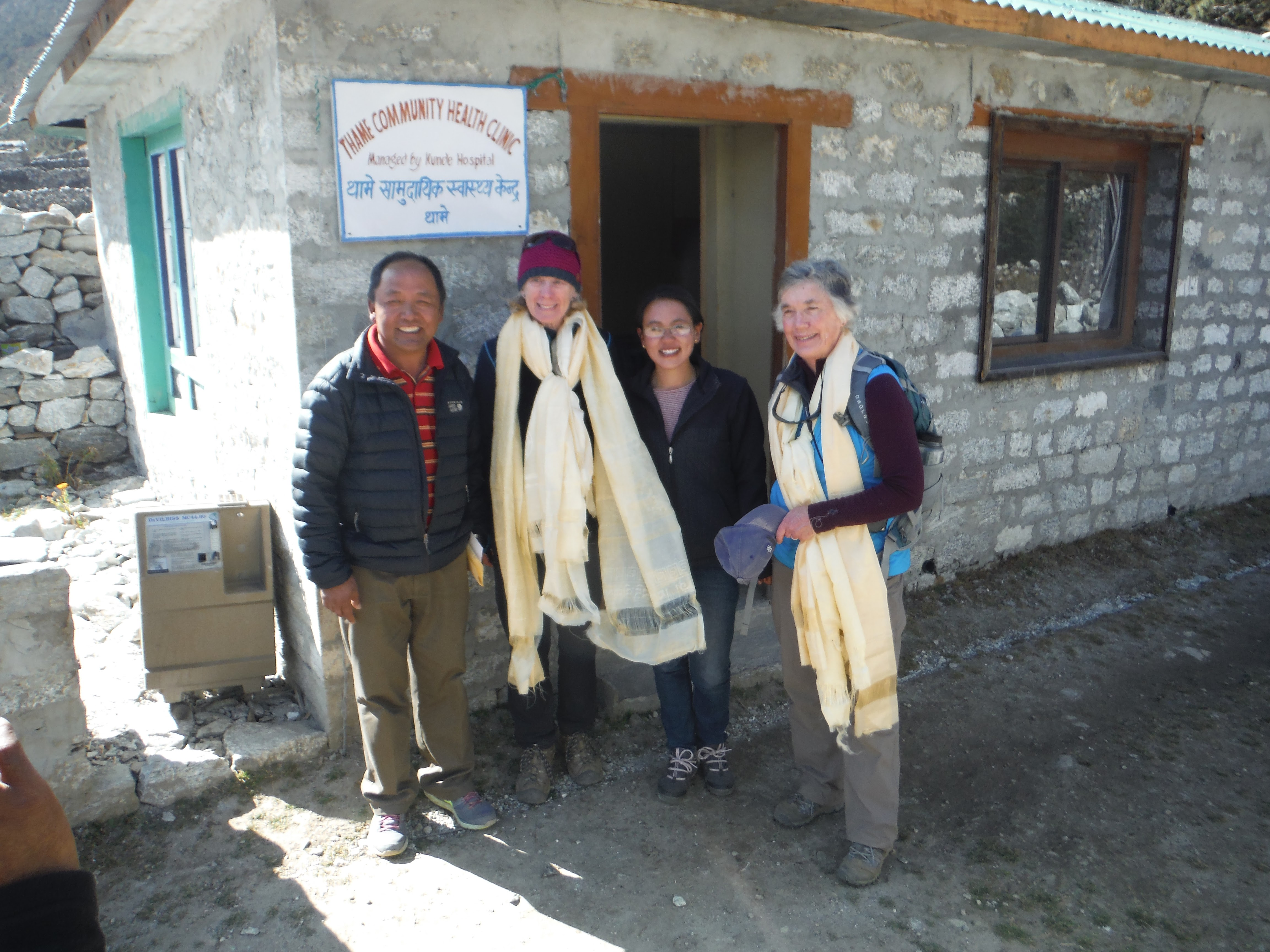 Denise Coriell and Leeli Bonney of the Tara Foundation USA at the Thame Clinic after it was rebuilt with Dr. Kami Sherpa and another health worker from the facility.