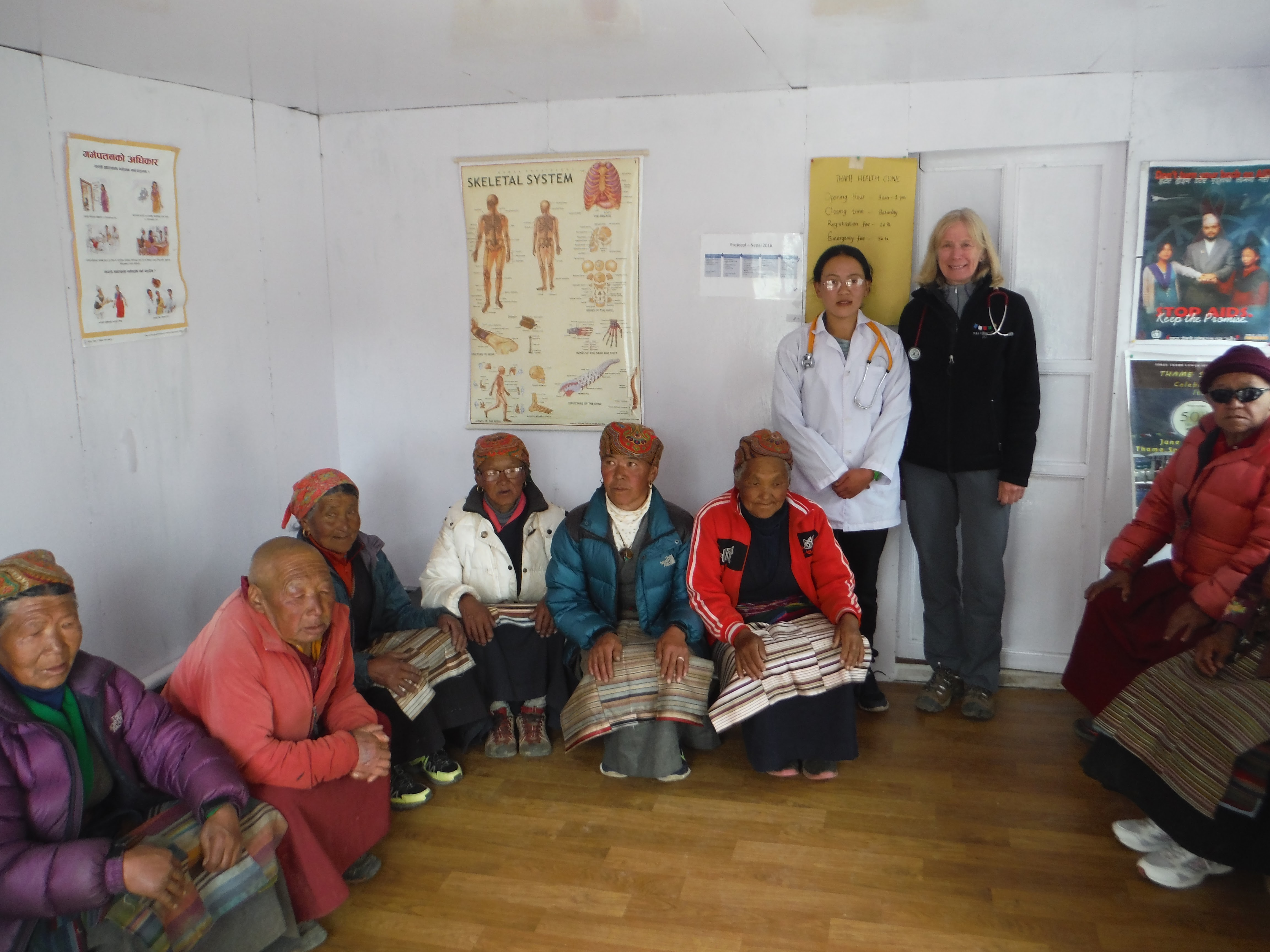 Denise Coriell of the Tara Foundation USA and a health worker from the Thame Clinic in Nepal helping people at the clinic.