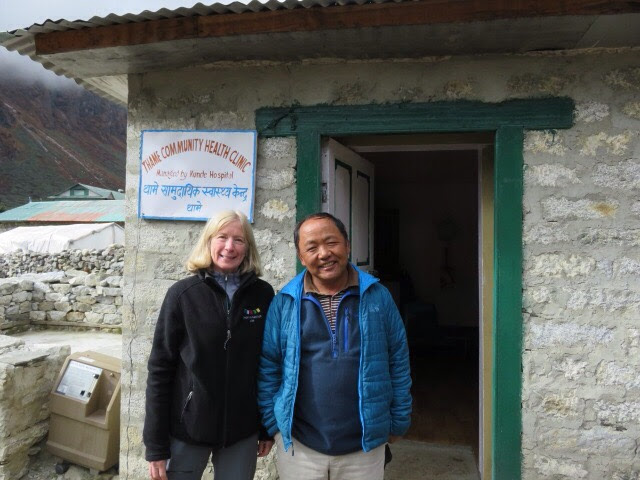 Denise Coriell of Tara Foundation USA and Dr Kami Sherpa in front of the Thame Clinic in Nepal.